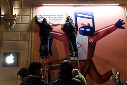 Activists of the Attac association have carried out a collage action on the temporary facade of the future Apple Store on the Champs-Elysées in order to denounce the tax evasion of the Apple brand. Paris, France, November 12, 2018. Photo by Samuel Boivin / ABACAPRESS.COM