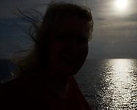 Sunrise Breakfast Club. Silhouette sunrise portrait. MV World Odyssey At Sea. Image taken with a Fuji X-T1 camera and 23 mm f/1.4 lens (ISO 200, 23 mm, f/10, 1/4000 sec)