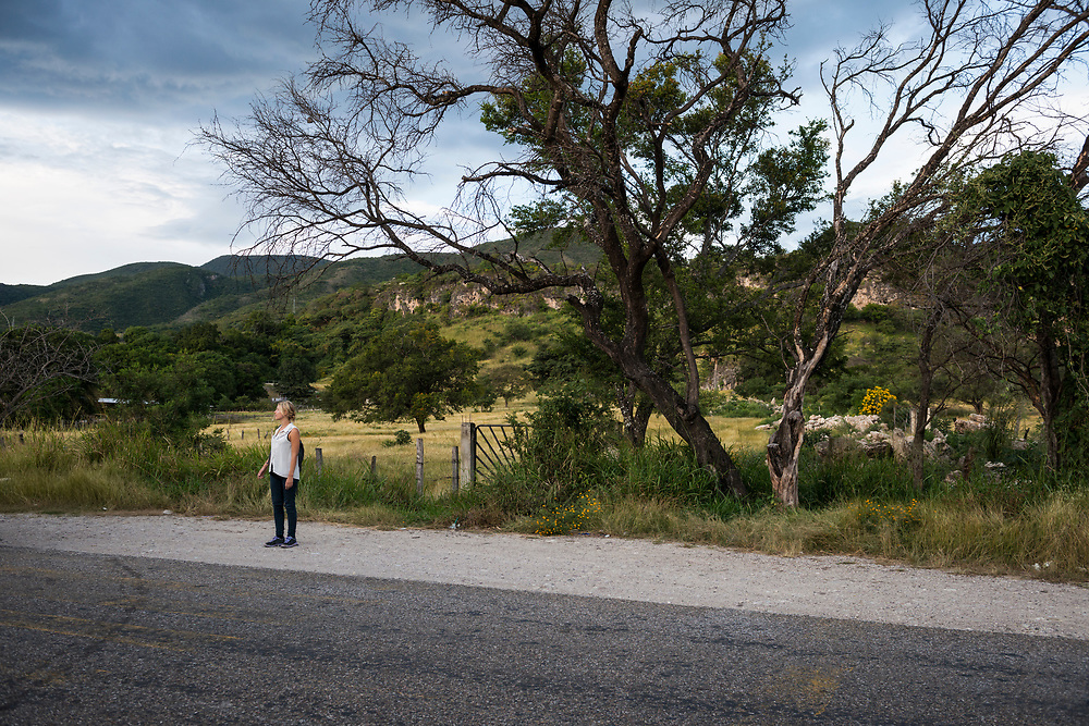A young woman traveling in Mexico stands on the side of Highway 226 about 20 miles outside the city of Comitan in Chiapas, Mexico