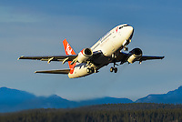 C-GANU takes off for Kelowna and Vancouver in the late-afternoon sun