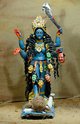 A small statue of the goddess Durga represented as Kali created specifically for the period of the Durga Puja and housed in a pandal in Kolkata.  Kolkata, Republic of India. 09 November 2007.