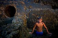 portrait of cuban boy swimming on the coast