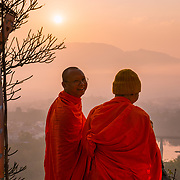 Lao monks at sunrise in Luang Prabang