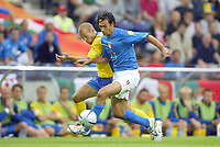 Italy v Sweden - Estadio Dragao, Porto - 18th June 2004<br />Italy's Alessandro Nesta fights for the ball with Sweden's Freddie Ljungberg<br />Photo: Jed Leicester/Sporting Pictures<br />© Sporting Pictures (UK) Ltd<br />www.sportingpictures.com<br />Tel: +44 (0)20 7405 4500<br />Fax: +44 (0)20 7831 7991