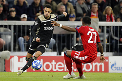 (l-r) Noussair Mazraoui of Ajax, David Alaba of FC Bayern Munchen during the UEFA Champions League group E match between Bayern Munich and Ajax Amsterdam at the Allianz Arena on October 02, 2018 in Munich, Germany