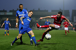 Charlton Athletic's Lewis Page and AFC Wimbledon's Barry Fuller and Tom Soares in action