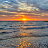 Cape Cod Bay and Herring Brook Beach at sunset. This beautiful Cape beach is located in Eastham, Massachusetts and only a few steps from one of Cape Cod's most iconic lighthouses Nauset Beach Light, famous for its logo appearance on the Cape Cod chips.<br /> <br /> Massachusetts Cape Cod Bay Herring Brook Beach fine art photography images are available as museum quality photography prints, canvas prints, acrylic prints or metal prints. Fine art prints may be framed and matted to the individual liking and decorating needs:<br /> <br /> https://juergen-roth.pixels.com/featured/sunset-at-cape-cod-bay-herring-brook-beach-juergen-roth.html<br /> <br /> All New England photos are available for photography image licensing at www.RothGalleries.com. Please contact Juergen with any questions or request. <br /> <br /> Good light and happy photo making!<br /> <br /> My best,<br /> <br /> Juergen