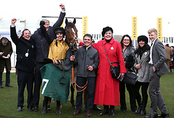 Trainer Ben Case, horse Croco Bay with jockey Kielan Woods after victory at the Johnny Henderson Grand Annual Challenge Cup Handicap Chase during Gold Cup Day of the 2019 Cheltenham Festival at Cheltenham Racecourse.