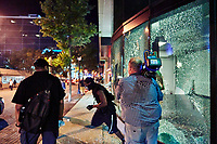Durning the 2nd night of rioting in Atlanta due to the killing of George Floyd, protestors break windows out in downtown Atlanta.