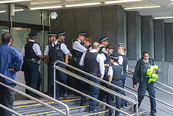 A large police presence is in evidence after intimidation and threats made against a journalist by supporters of  rising drill music rapper UnknownT - real name Daniel Lena who is appearing alongside Ramani Boreland, on charges of the murder of of Steven Narvaez-Jara, 20, together with Mohammed Mussa who is charged with violent disorder on New Year's Day last year at Highbury Corner Magistrates Court.