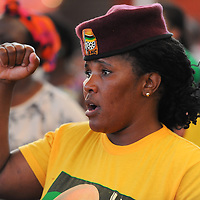 KHAYELITSHA, SOUTH AFRICA - Monday 9 December 2013, the City of Cape Town hosted an Evening of Remembrance at the OR Tambo hall, Khayelitsha. for the late former President of South Africa, Nelson Mandela. A Member of the ANC Womans League, raises her fist during the singing of the national anthem.<br /> Photo by Roger Sedres/ImageSA
