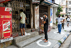 Queue outside a liquor store in Kolkata, India on May 5, 2020. Goverment ordered to open liquor shop amidst 14 days of extended lockdown in India. Guidelines were put forth and social distancing protocols were ordered to be followed at any cost during working hour of the liquor shop in the country. Photo by Debarchan Chatterjee/ABACAPRESS.COM