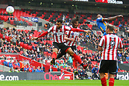 Shrewsbury Town's Omar Beckles get in a header during the EFL Trophy Final match between Lincoln City and Shrewsbury Town at Wembley Stadium, London, England on 8 April 2018. Picture by John Potts.