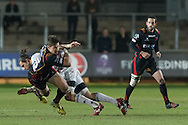 Carl Meyer of the Newport Gwent Dragons is taken down by William Whetton of Brive. European Challenge cup pool 3 match, Newport Gwent Dragons v Brive, at Rodney Parade in Newport, South Wales on Friday 14th October 2016.<br /> pic by  Simon Latham, Andrew Orchard sports photography.