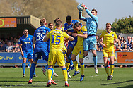 Bristol Rovers goalkeeper Jack Bonham (13) making a save from a cross during the EFL Sky Bet League 1 match between AFC Wimbledon and Bristol Rovers at the Cherry Red Records Stadium, Kingston, England on 19 April 2019.