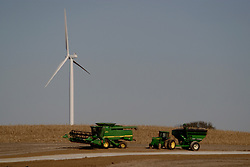 29 October 2006: Unattended farm implements sit in a harvested field in the shadow of a new windmill.  The windmill will be a part of a large wind farm in eastern McLean County, Illinois.<br />