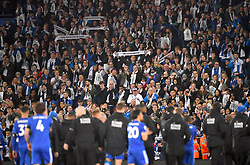 Fans in the stands wave scarves in tribute to Leicester City chairman, Vichai Srivaddhanaprabha who lost his life in the Leicester City helicopter crash during the Premier League match at the King Power Stadium, Leicester.