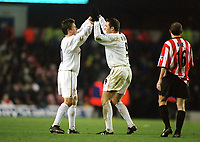 Mark Viduka and Harry Kewell (both Leeds) celebrate Leeds' second goal, Leeds Utd v Sunderland, 16/12/2000. Credit Colorsport / Andrew Cowie.