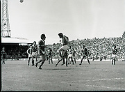 League of Ireland vs Liverpool FC.    (M87)..1979..18.08.1979..08.18.1979..18th August !979..In a pre season friendly the League of Ireland took on Liverpool FC at Dalymount Park Phibsborough,Dublin. The league team was made up of a selection of players from several League of Ireland clubs and was captained by the legendary John Giles. Liverpool won the game by 2 goals to nil..The scorers were Hansen and McDermott...Noel Synnott is pictured heading the ball clear to break up a liverpool attack.