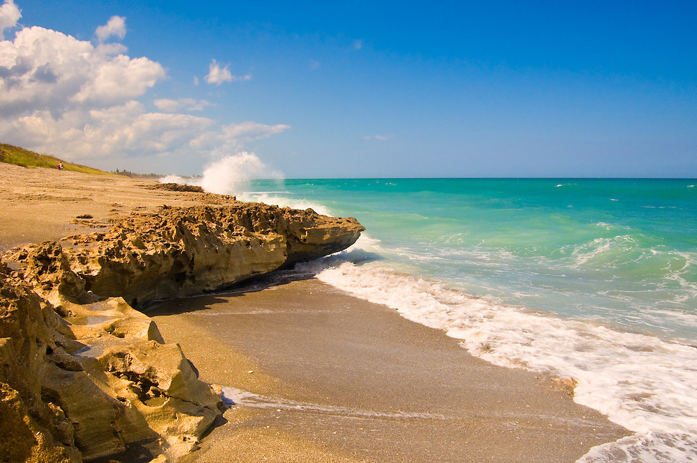 Amazing rock formations at the Blowing Rocks Preserve on Jupiter Island, Florida. This limestone rock wall is an exposed ancient coral reef that gets pounded by the Atlantic Ocean incessantly.