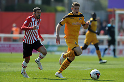 Newport County's Yan Klukowski is tackled by Exeter City's Liam Sercombe - Photo mandatory by-line: Harry Trump/JMP - Mobile: 07966 386802 - 06/04/15 - SPORT - FOOTBALL - Sky Bet League Two - Exeter City v Newport County - St James Park, Exeter, England.