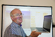 """14/10/2014 Bredan """"Speedie"""" Smith who is teaching coding all over Galway including retired Galway teachers at the Galway Education centre learning coding   during the EU CODE WEEK. Photo:Andrew Downes"""
