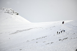 © Licensed to London News Pictures. 04/12/2020. <br /> People head up towards the summit of Penyfan, in the Brecon Beacons, the highest point in southern Wales and England, which has seen it's first snowfall of the year. Photo credit: Robert Melen/LNP