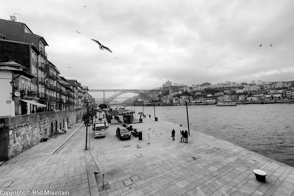 Porto, Portugal - February 13, 2018 - Looking towards Luís I Bridge in Porto, Portugal. The double deck metal arch bridge spans the River Douro and was completed in 1886, connecting Vila Nova de Gaia and Porto.<br /> <br /> Image: © Rod Mountain<br /> <br /> http://www.rodmountain.com<br /> <br /> @visitportugal @visitporto.portal<br /> @TurismoPortoNortePortugal @TurismodePortugal<br /> <br /> #Heritage #Architecture #bnw_city #bnw_captures #instablackandwhite #bwphoto #bw_shotz #blackandwhite_perfection #best_bnw_archive #foto_bw #bandw #noirlovers #bwsquare #Wonderful_Places #letsgosomewhere #touring #places_wow #instapassport #TLPicks #Travelgram #beUrban #bwstyleoftheday #streetsgrammer #quietstranger #worldshotz #wanderlust #porto<br /> <br /> #NikonCA #NikonNoFilter #NikonEurope<br /> Nikon D800 / Nikkor Lens @nikoncanada @nikoneurope<br /> <br /> https://en.wikipedia.org/wiki/Porto<br /> https://www.visitportugal.com/en<br /> https://en.wikipedia.org/wiki/Portugal<br /> https://en.wikipedia.org/wiki/Dom_Lu%C3%ADs_I_Bridge
