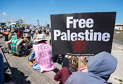 © Licensed to London News Pictures; 12/06/2021; Hayle, Cornwall UK. G7 summit in Cornwall. Supporters of Palestine at the Resist G7 coalition of protest groups protest in Hayle on the second day of the G7 summit. The protest included supporters of Palestine and of Kashmir as well as anti-war groups and socialists and trade unionists. Photo credit: Simon Chapman/LNP.