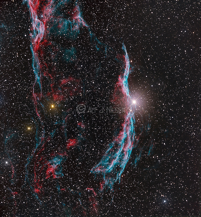 Western Veil nebula (NGC 6960) with the foreground star 52 Cygni in the constellation Cygnus. The nebula is the remnant of a supernova explosion occuriing 10 000 - 20 000 years ago.