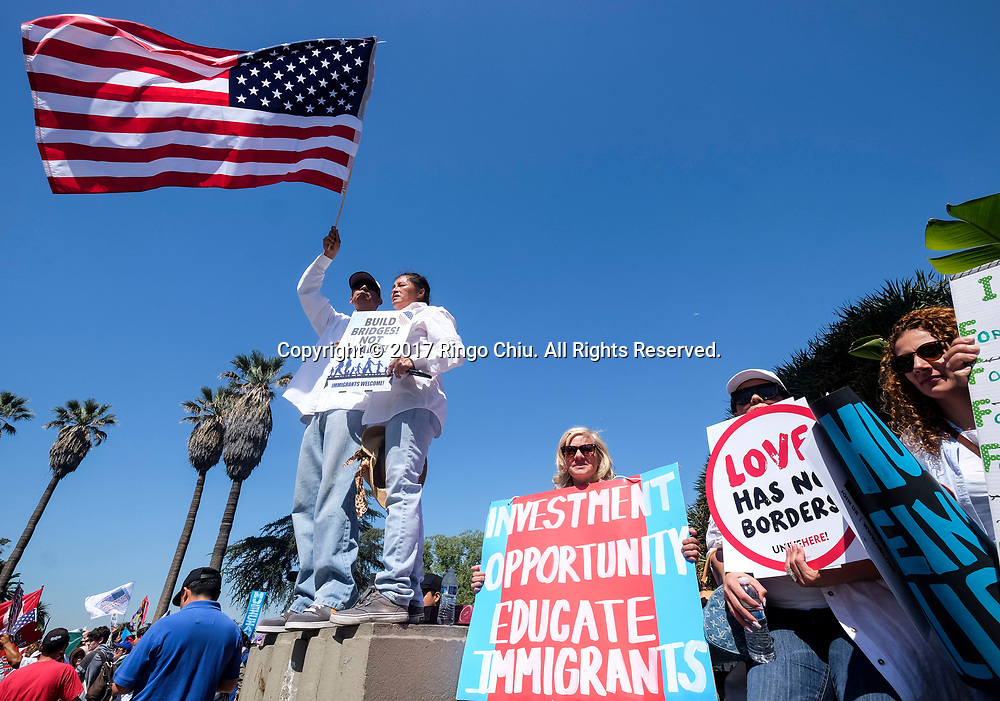 Protesters holds a U.S. flag before marching toward downtown Los Angeles in the annual May Day March in Los Angeles, May 1, 2017. (Photo by Ringo Chiu/PHOTOFORMULA.com)<br /> <br /> Usage Notes: This content is intended for editorial use only. For other uses, additional clearances may be required.