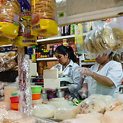 Women selling cheese at a market stall in Cholula, Mexico