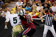 4/12/2007 - Antar Brame (21) tries to avoid contact with Frisco's Jon Makonnen (5) but gets called for a penalty.  The Alaska Wild could only score 33 points against the 46 points by the Frisco Thunder in the first professional football game in Alaska.