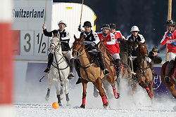 Gonzalo Bourdieu chasing the ball for team Germany<br /> St.Moritz Polo World Cup On Snow 2011<br /> © Dirk Caremans