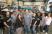 The T.G.I.F. Body Shop, Inc., team poses for a photo at T.G.I.F. Body Shop, Inc., in Fremont, California, on April 17, 2014. (Stan Olszewski/SOSKIphoto)