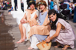 Granary Square, Kings Cross, London, August 30th 2014.  Women dressed in Roman attire take a break during the Battle Bridge: Boudicca Vs The Romans event, which aims to bring alive the ancient history associated with King's Cross.  PAYMENT/CONTACT DETAILS: paul@pauldaveycreative.co.uk Tel +44 (0) 7966 016 296 or +44 (0) 208 969 6875