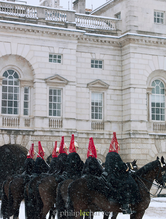 Changing of the Guard at Horseguards Parade in the snow, London, UK