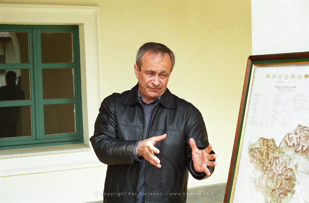 """The Kiralyudvar winery in Tarcal: Isztvan Szepsy, manager, wine maker and co-owner, gesticulating in front of a map of the region. Kiralyudvar (meaning """"King's Court"""")is run by Istvan Szepsy, considered maybe the best winemaker in Tokaj. he also makes Tokaj under his own name.  Credit Per Karlsson BKWine.com"""