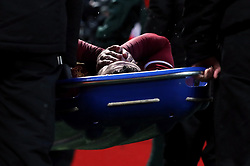 Liverpool's Alex Oxlade-Chamberlain leaves the pitch on a stretcher
