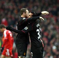 Photo: Mark Stephenson/Sportsbeat Images.<br /> Liverpool v Manchester United. The FA Barclays Premiership. 16/12/2007.Carlos Tevez (R) celebrates his goal with Wayne Rooney