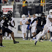 ORLANDO, FL - OCTOBER 03:  T.K. Wilkerson #21 of the Tulsa Golden Hurricane outruns the Central Florida Knight defense at Bright House Networks Stadium on October 3, 2020 in Orlando, Florida. (Photo by Alex Menendez/Getty Images) *** Local Caption *** T.K. Wilkerson