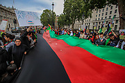 """Demonstrators chanted """"Death to America!"""" """"Death to Pakistan"""" as they carry the Afghan National Flag and march towards Parliament Square during a protest """"Save Afghanistan"""" outside Downing Street, Britain's PM Office in central London on Saturday, Aug 21, 2021. (VX Photo/ Vudi Xhymshiti)"""