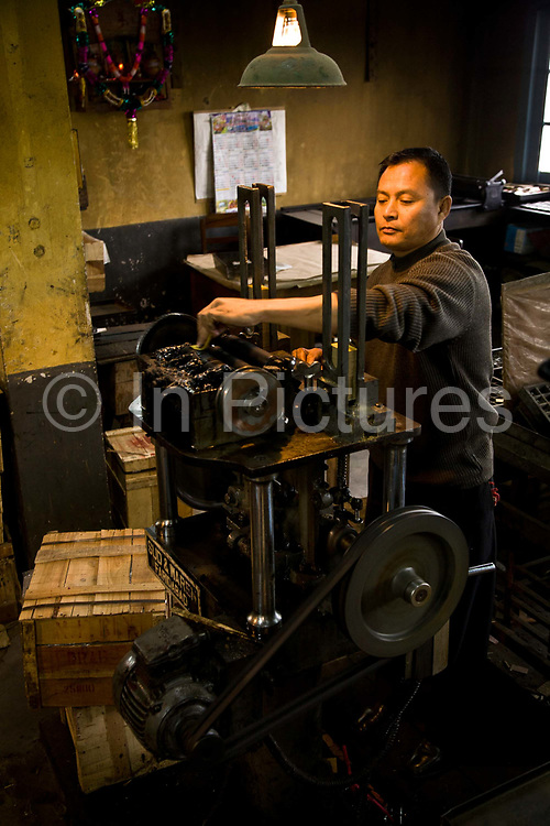 """At Kurseong railway station the old ticket printing press still operates to capacity.   The Darjeeling Himalayan Railway, nicknamed the """"Toy Train"""", is a narrow-gauge railway from Siliguri to Darjeeling in West Bengal, run by the Indian Railways. It was built between 1879 and 1881 and is about 86 km long. The elevation level is from about 100 m at Siliguri to about 2200 m at Darjeeling. It is still powered by a steam engine and travels daily between the two towns, as well as a shorter route to Kurseong.  It is now classed as a World Heritage Site by UNESCO. India."""