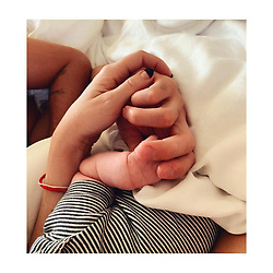 """Kate Hudson releases a photo on Instagram with the following caption: """"Two hands are missing to complete this family portrait but it\u2019s far to early for my big guys \u2764\ufe0f #SleepyHeads #FeedTime #AllDayEveryDay"""". Photo Credit: Instagram *** No USA Distribution *** For Editorial Use Only *** Not to be Published in Books or Photo Books ***  Please note: Fees charged by the agency are for the agency's services only, and do not, nor are they intended to, convey to the user any ownership of Copyright or License in the material. The agency does not claim any ownership including but not limited to Copyright or License in the attached material. By publishing this material you expressly agree to indemnify and to hold the agency and its directors, shareholders and employees harmless from any loss, claims, damages, demands, expenses (including legal fees), or any causes of action or allegation against the agency arising out of or connected in any way with publication of the material."""