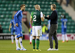 Molde's manager, Ole Gunnar Solskjaer (right) speaks with Hibernian captain and former Manchester United colleague David Gray after the UEFA Europa League third qualifying round, first leg match at Easter Road, Edinburgh.