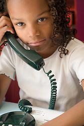 Girl using telephone,