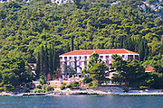 A beach hotel near the village. Orebic town, holiday resort on the south coast of the Peljesac peninsula. Orebic town. Peljesac peninsula. Dalmatian Coast, Croatia, Europe.