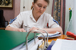 Nurse reading nursing journals at home,