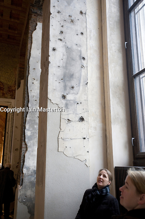 Bullet holes still visible on plasterwork on columns  of newly renovated and reopened Neues Museum in Berlin 2009 Architectect David Chipperfield