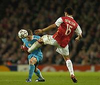 Photo: Olly Greenwood.<br />Arsenal v PSV Eindhoven. UEFA Champions League. Last 16, 2nd Leg. 07/03/2007. Arsenal's Denilson raises his foot to PSV's Jason Culina